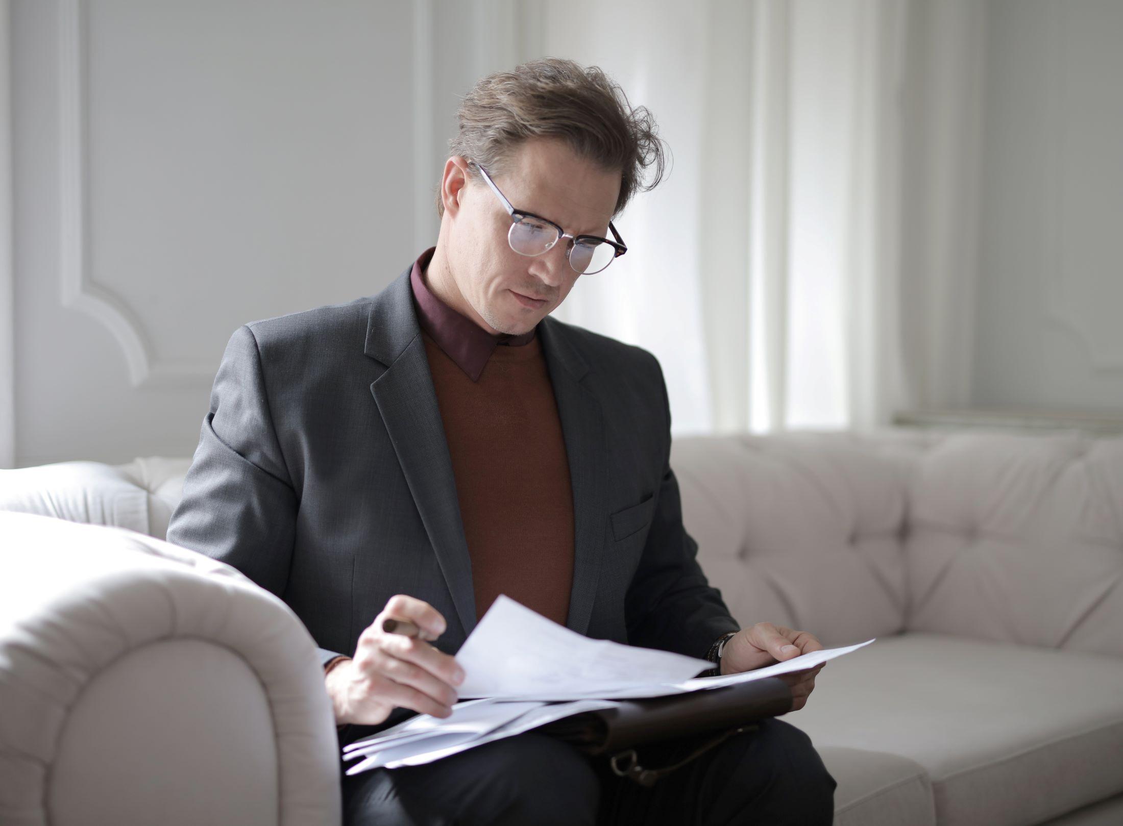 choose trustee estate planning man couch paperwork