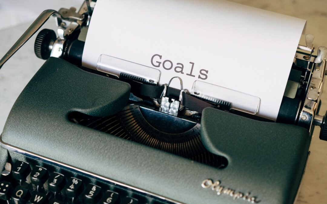 meeting your goals and planning your estate with life insurance old school manual typewriter with a sheet of paper goals