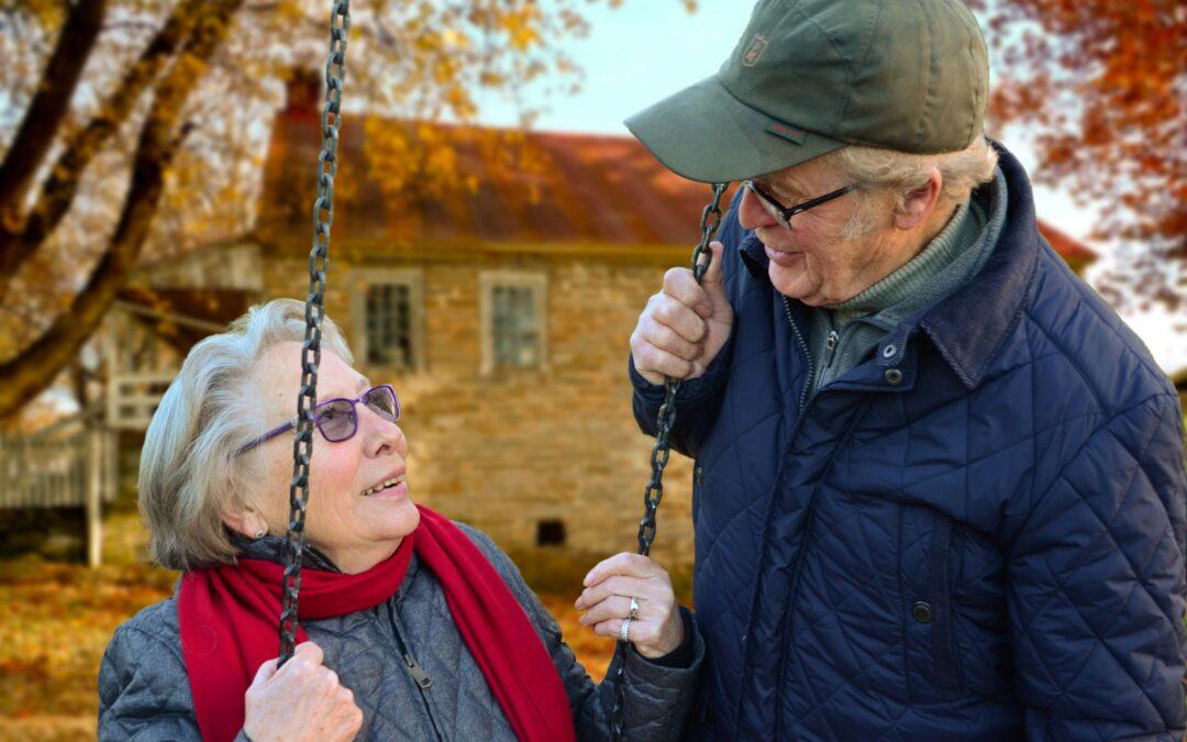 planning for medicare senior care coverage senior elderly couple man woman in swing